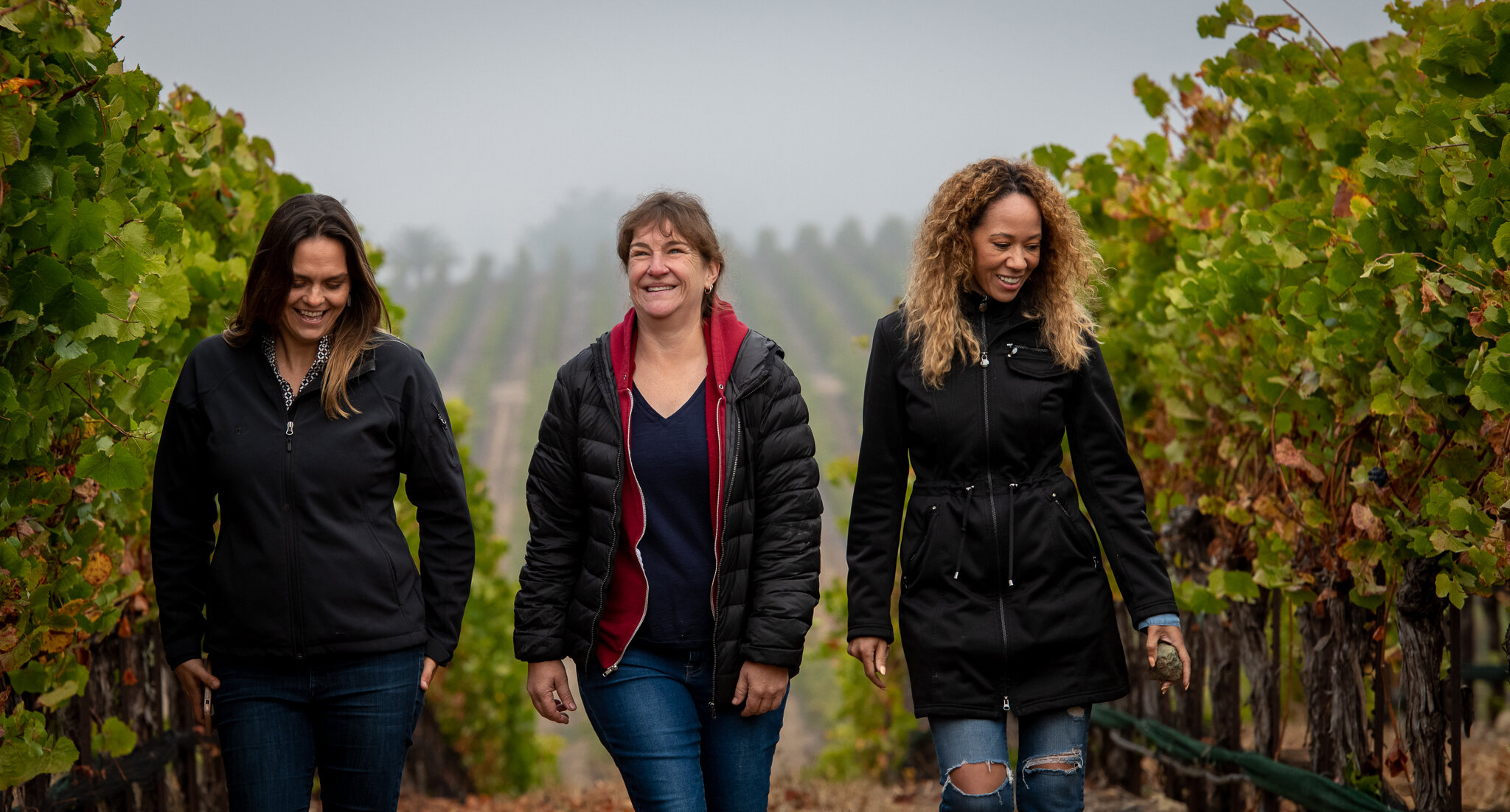 McBride Sisters in Vineyard with Winemaker
