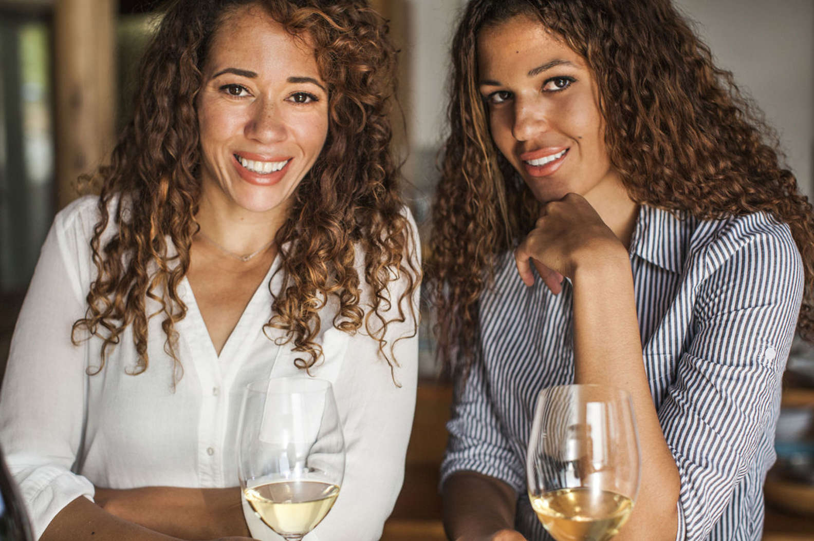 McBride sisters with their wine in wine glass Sauvignon Blanc McBride Sisters Collection